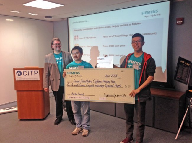 Princeton Electrical Engineering graduate students (L-R) Guangyuan Hu and Zecheng He have won the Siemens 2018 FutureMakers Challenge held at Princeton University.
