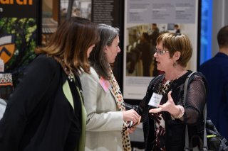 CEFR Coleen Burrus speaks with an attendee at a CEFR conference