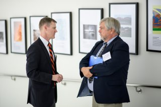Spencer Reynolds of Princeton CEFR speaks with an attendee at a Smart Cities event